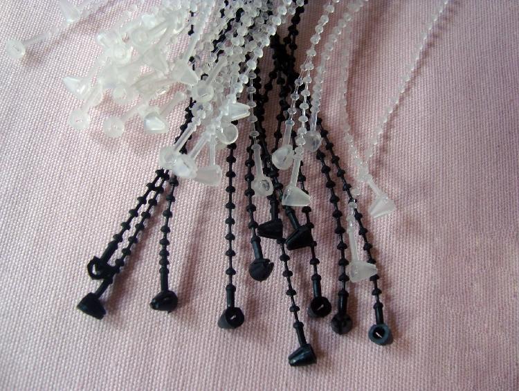 供应珠带 束带手穿针 带珠子母扣 吊牌珠带扣